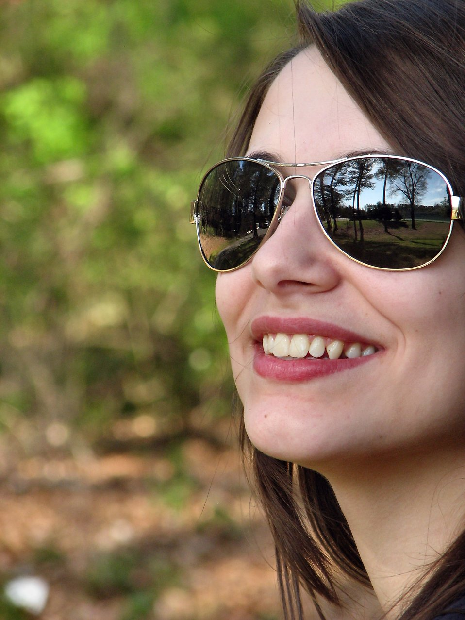 Close-up portrait of a beautiful girl posing outdoors : Free Stock Photo