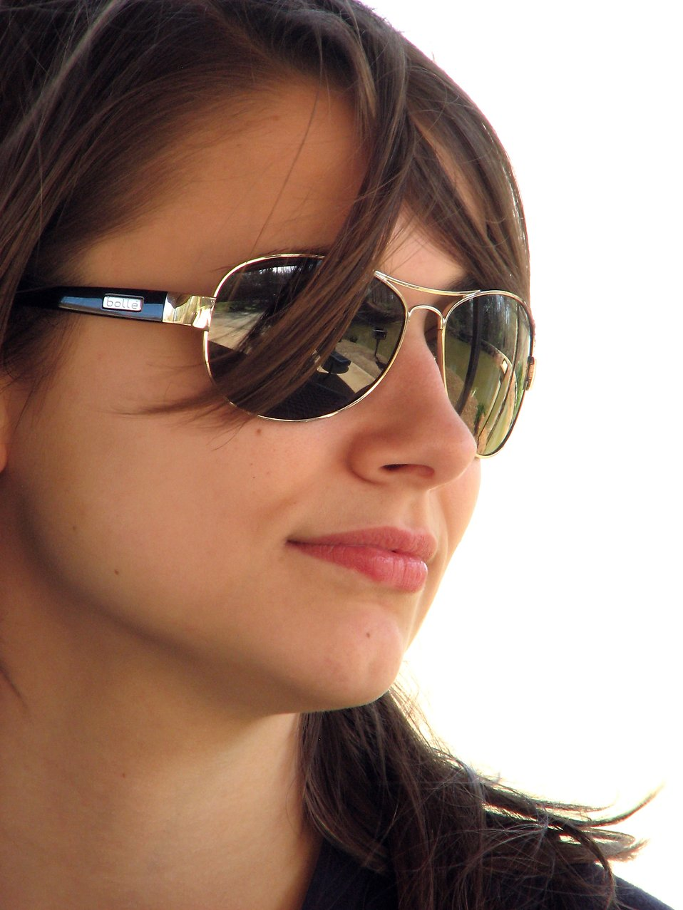 Close-up portrait of a beautiful girl wearing sunglasses.