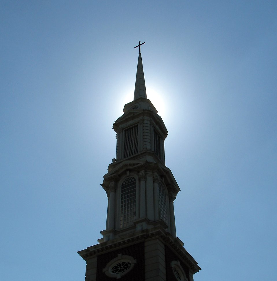 A church steeple with a cross : Free Stock Photo