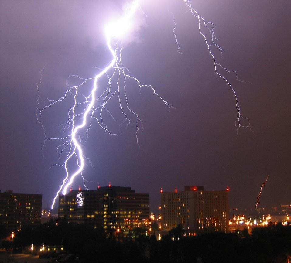 Lightning striking over a city : Free Stock Photo