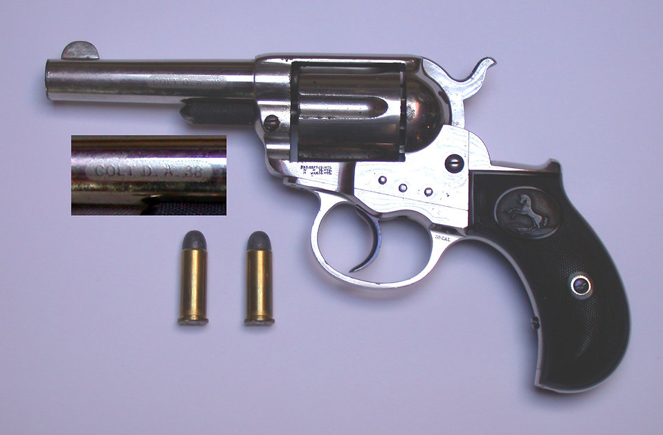 A colt 1877 Lightning pistol with bullets : Free Stock Photo