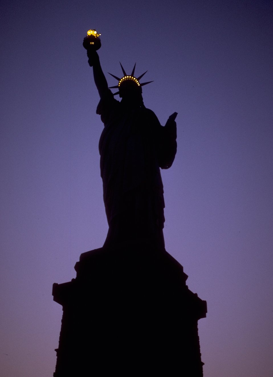Silhouette of the Statue of Liberty monument at night : Free Stock Photo