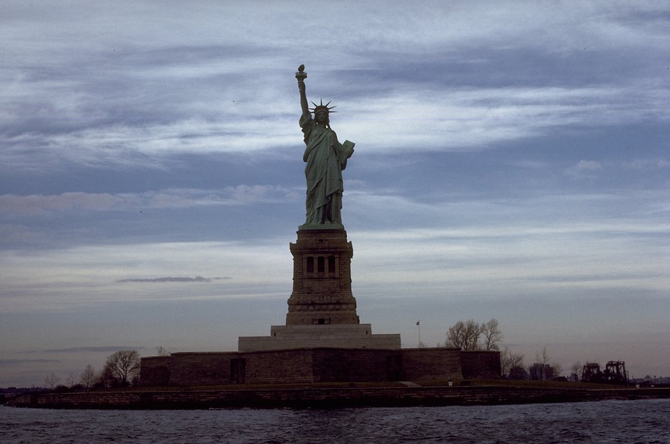 View of the Statue of Liberty monument on Liberty Island at dusk : Free Stock Photo