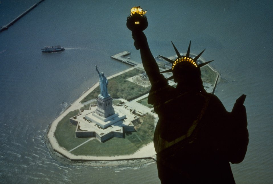 Aerial view of the Statue of Liberty monument on Liberty Island with a superimposed silhouette : Free Stock Photo