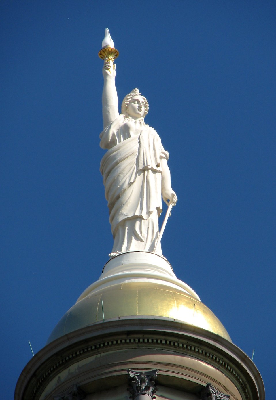 A statue on top of the Georgia State Capitol building in Atlanta, Georgia : Free Stock Photo
