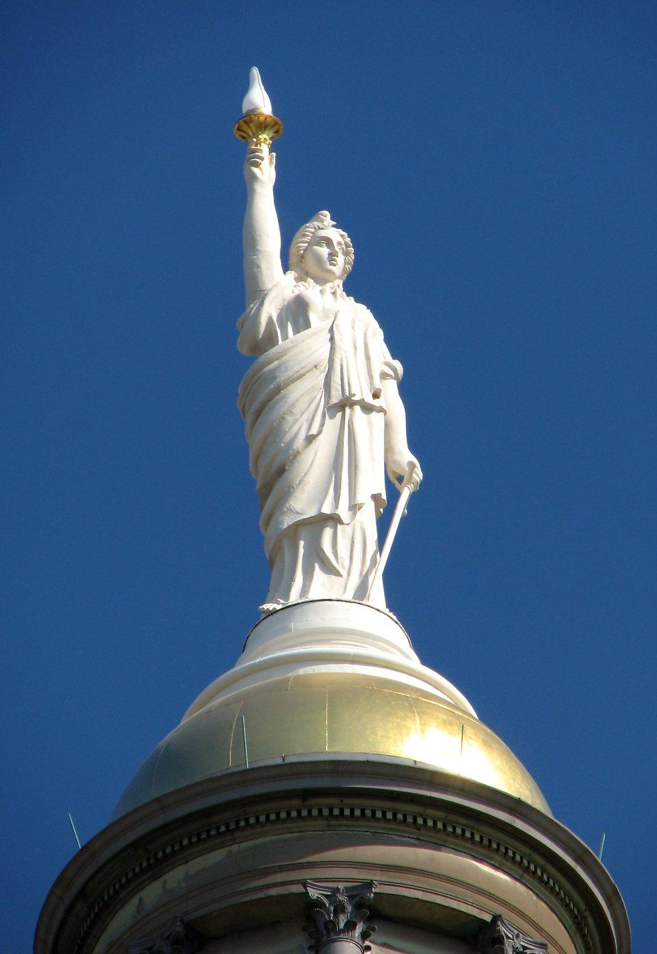 A statue on top of the Georgia State Capitol building in Atlanta, Georgia : Free Stock Photo