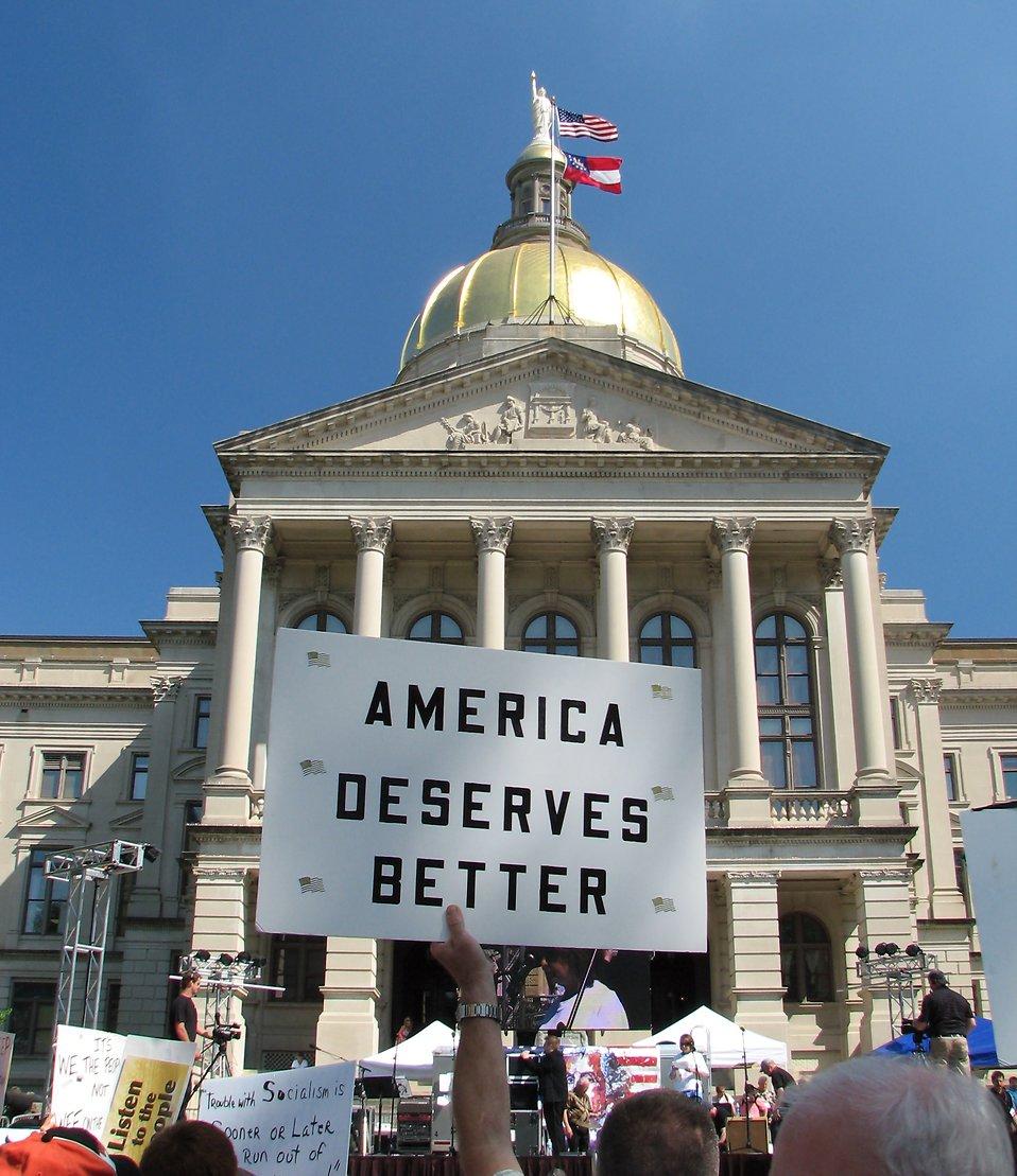 Protestors with signs at the 2010 Atlanta tax day tea party in Atlanta, Georgia : Free Stock Photo