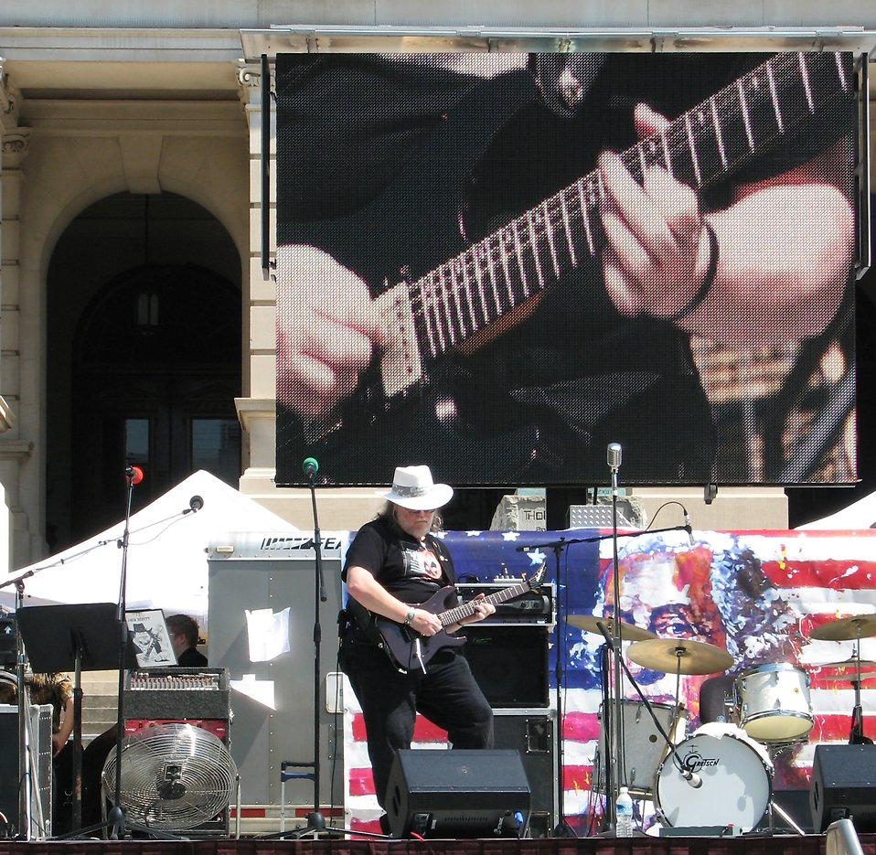 A man playing a guitar at the 2010 Atlanta tax day tea party in Atlanta, Georgia : Free Stock Photo