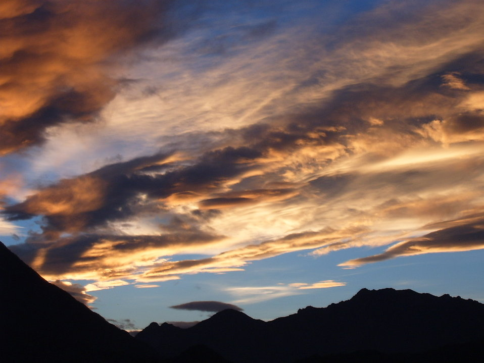 Clouds over the mountains at sunset : Free Stock Photo