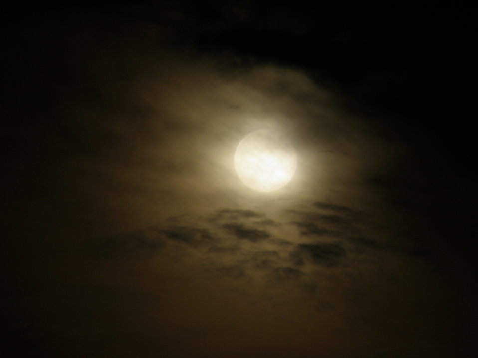 The moon shining through clouds at night : Free Stock Photo
