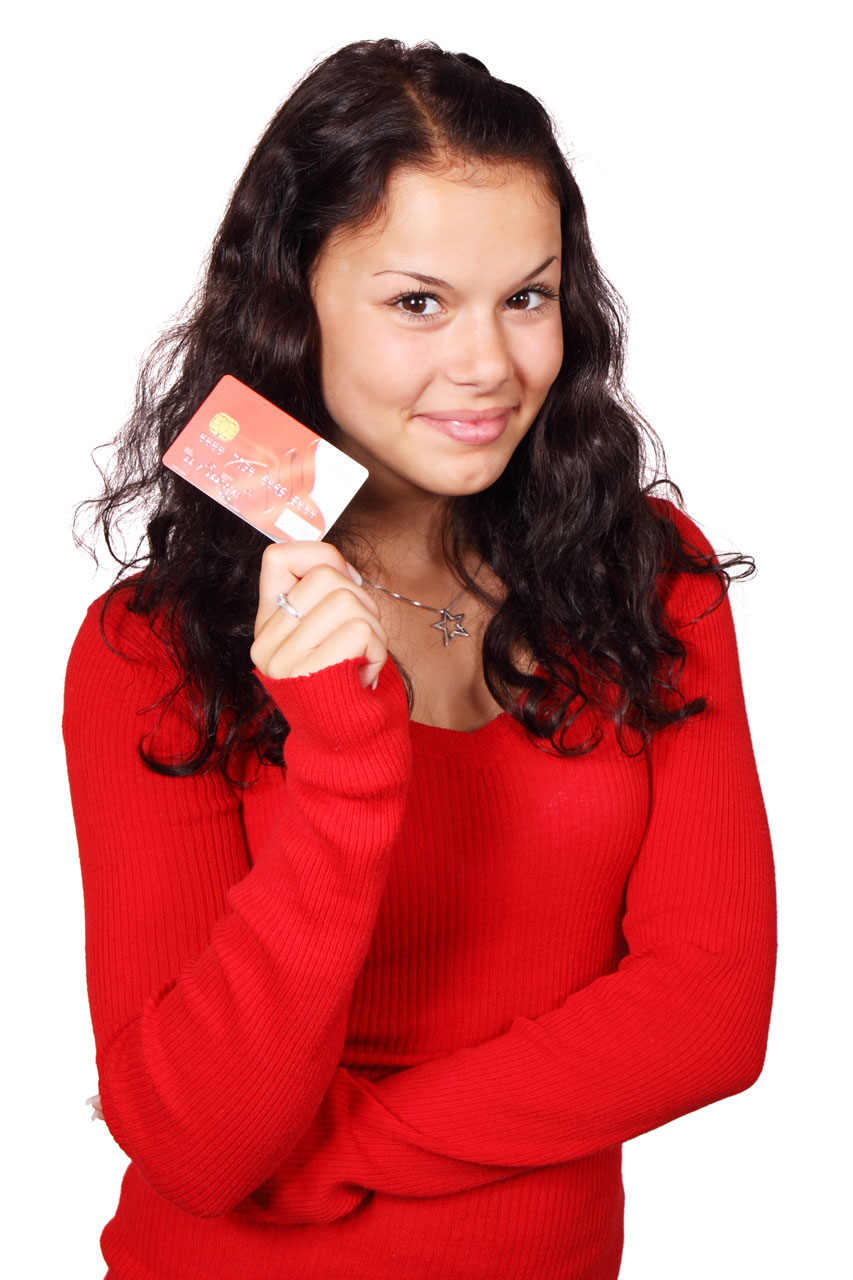 A beautiful woman holding a credit card : Free Stock Photo
