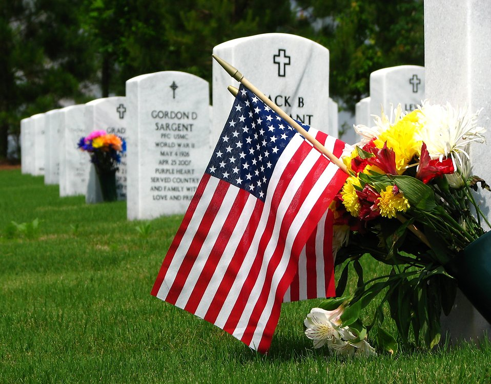 Close-up of gravestones and an American flag at the Georgia National Cemetery.