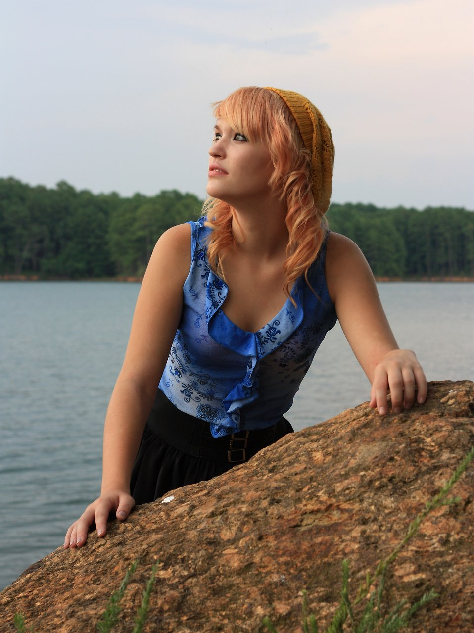 A beautiful young woman posing by a lake : Free Stock Photo