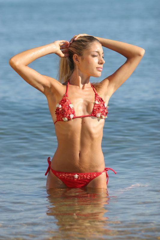A beautiful woman in a red bikini in the water : Free Stock Photo