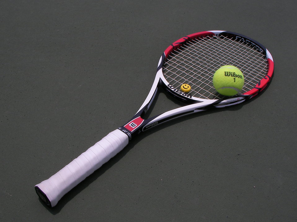 A tennis racquet and tennis ball : Free Stock Photo
