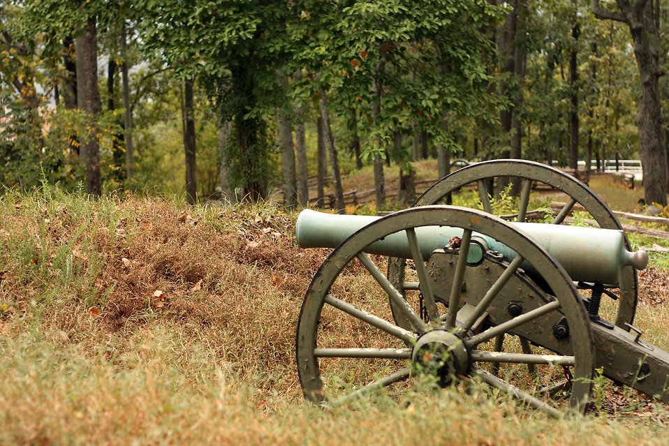 A Civil War era cannon in the woods : Free Stock Photo
