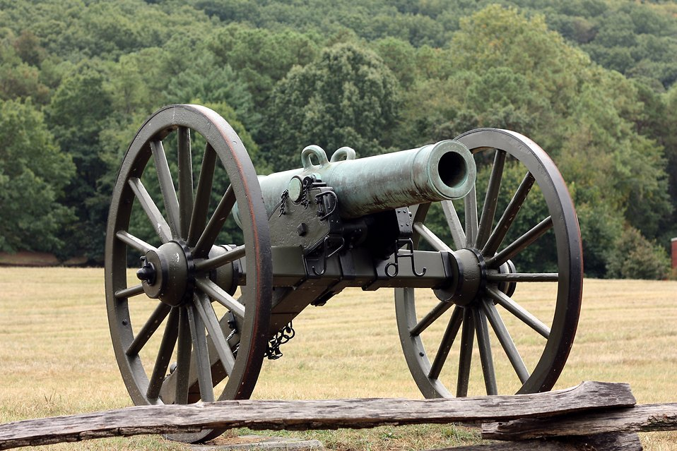 A Civil War era cannon on the edge of a field : Free Stock Photo