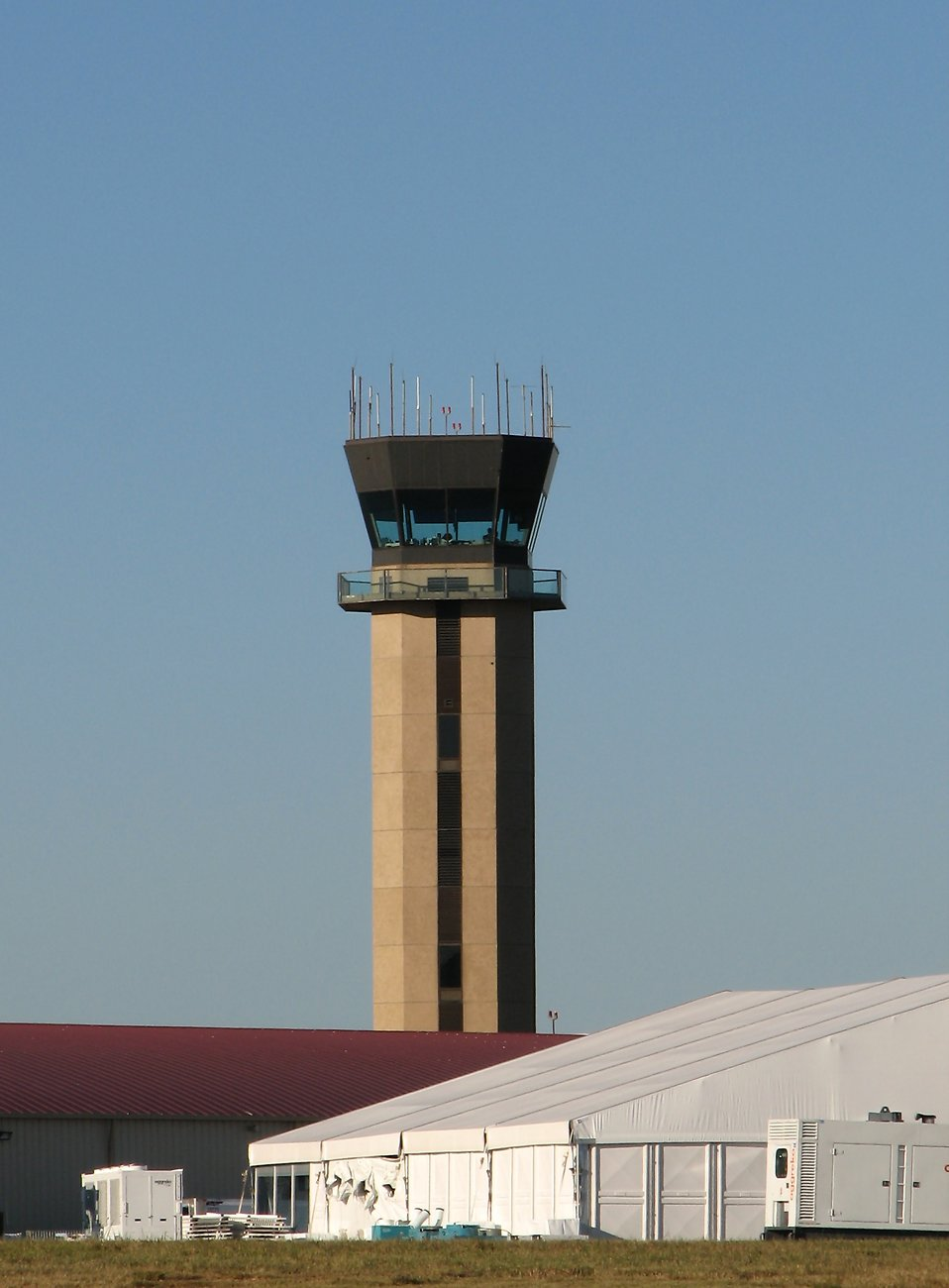 An air traffic control tower at a small airport : Free Stock Photo