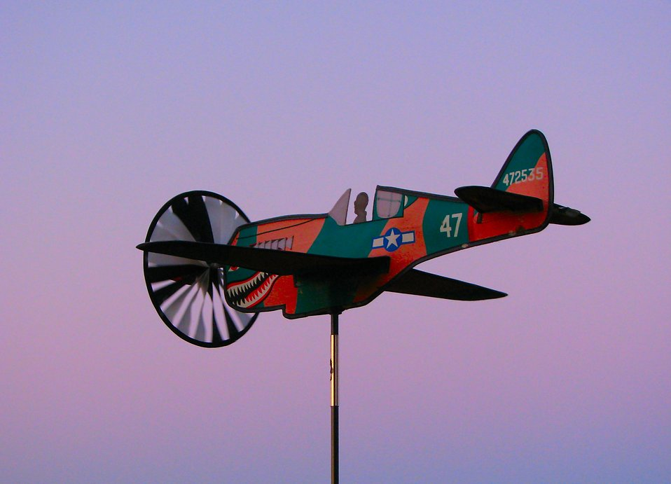 An airplane weather vane with a sunset background : Free Stock Photo