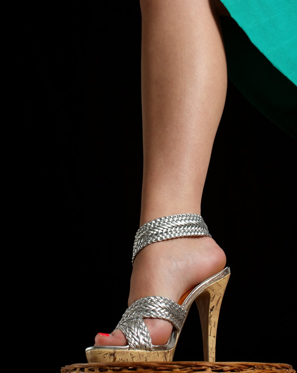 Close-up of a female leg wearing high heels : Free Stock Photo