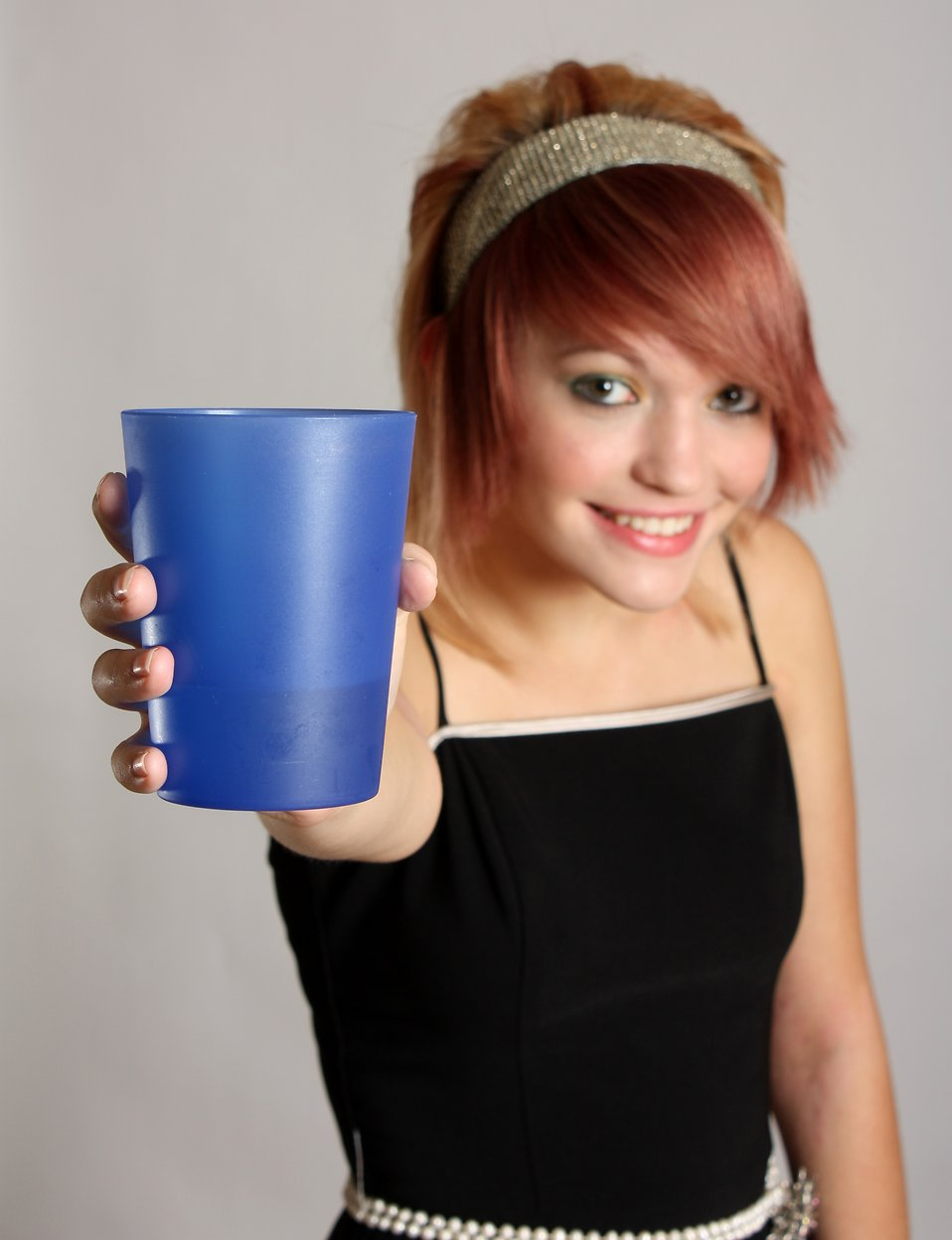 A beautiful girl offering a plastic cup drink : Free Stock Photo