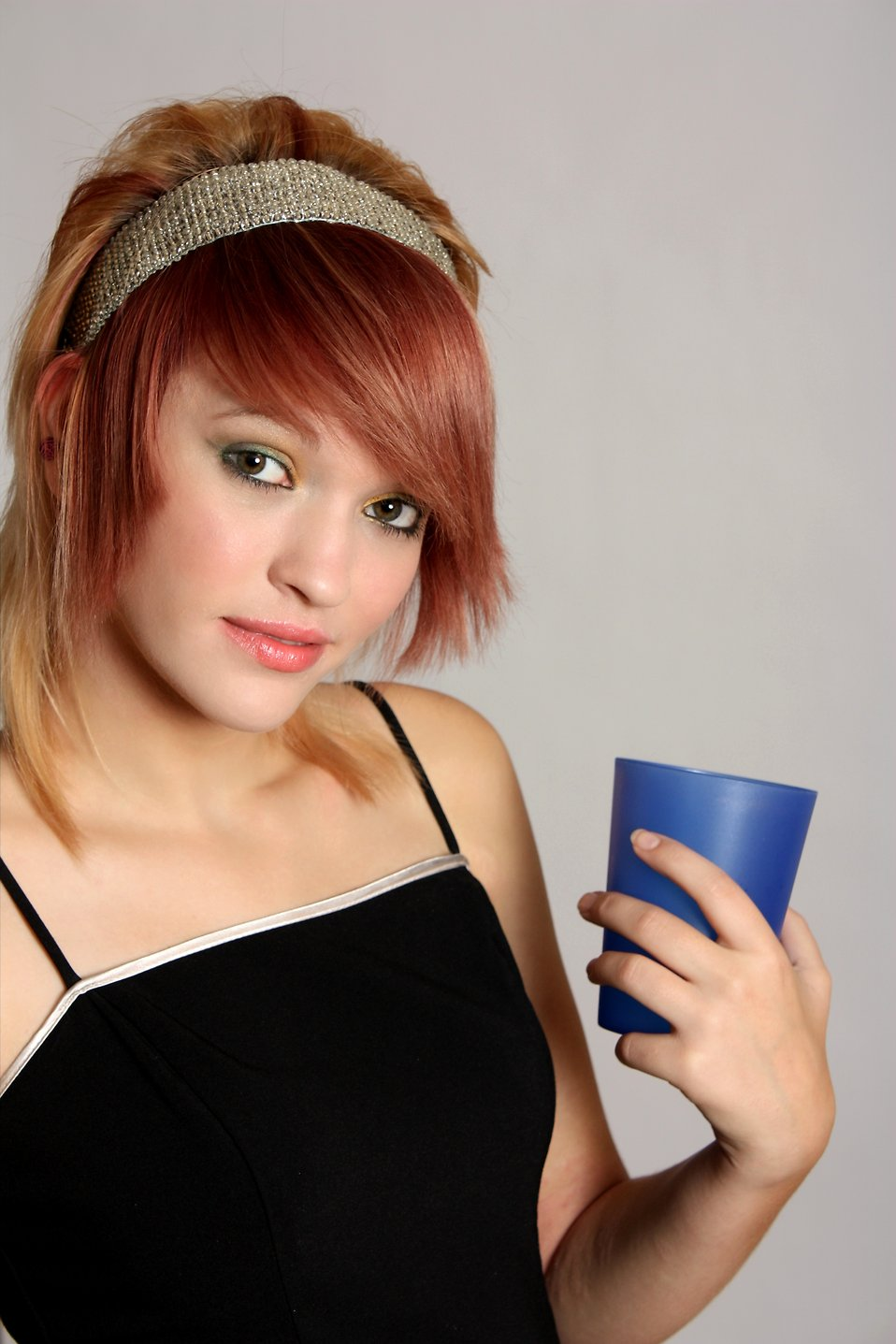 A beautiful girl holding a plastic cup : Free Stock Photo