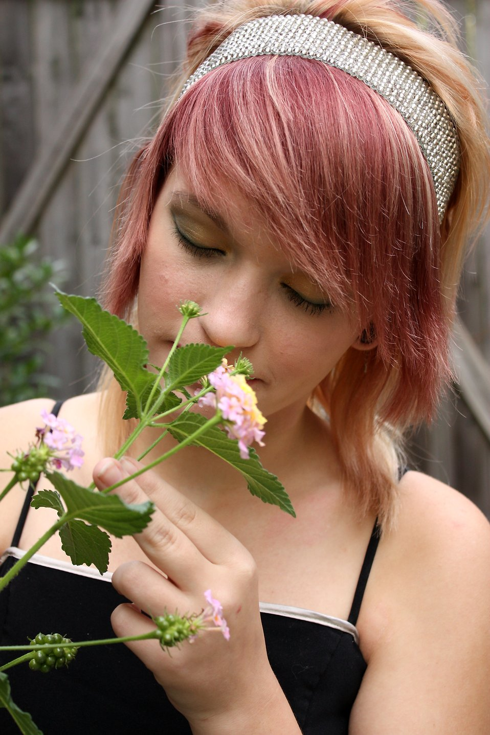 A beautiful young girl smelling flowers : Free Stock Photo