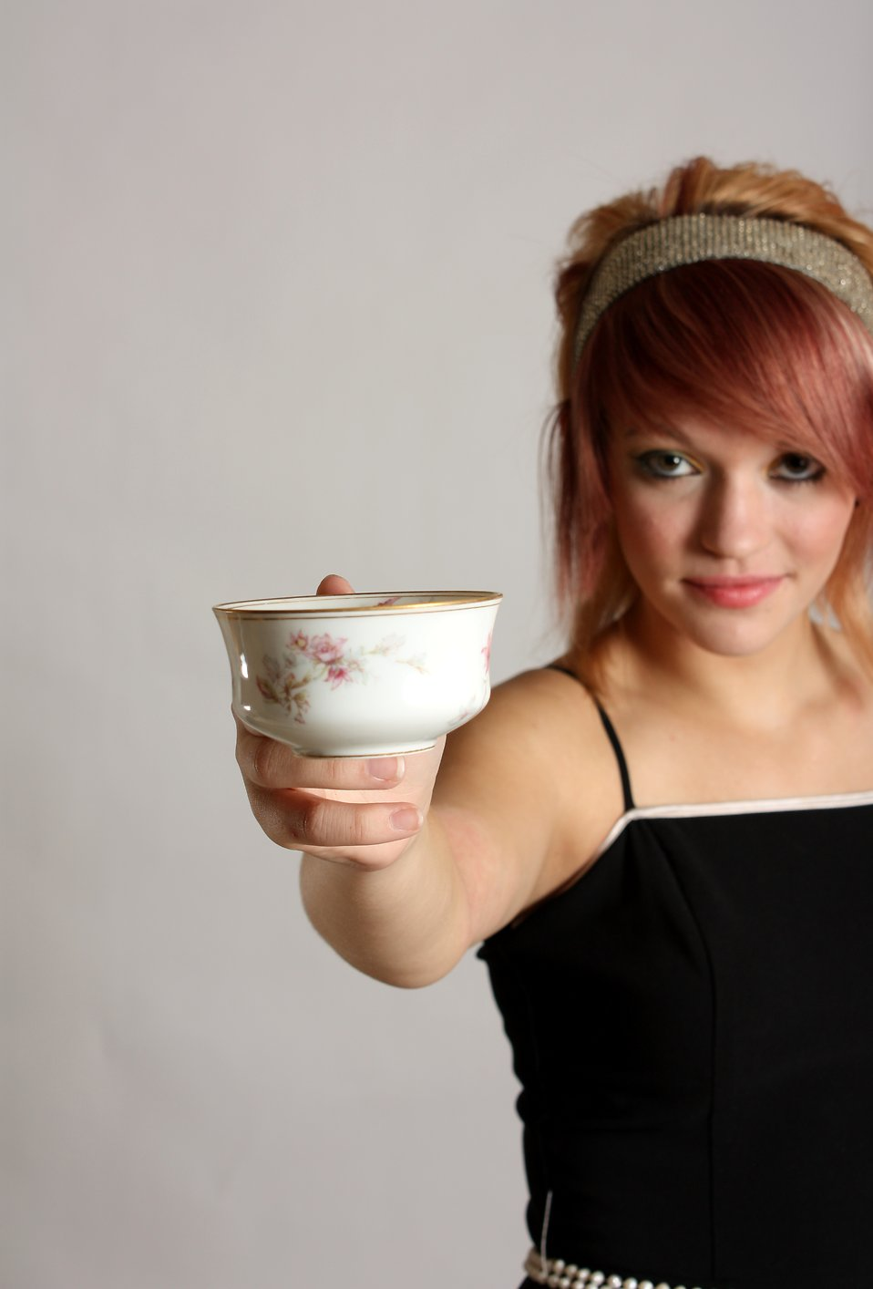A beautiful young woman holding a tea cup : Free Stock Photo