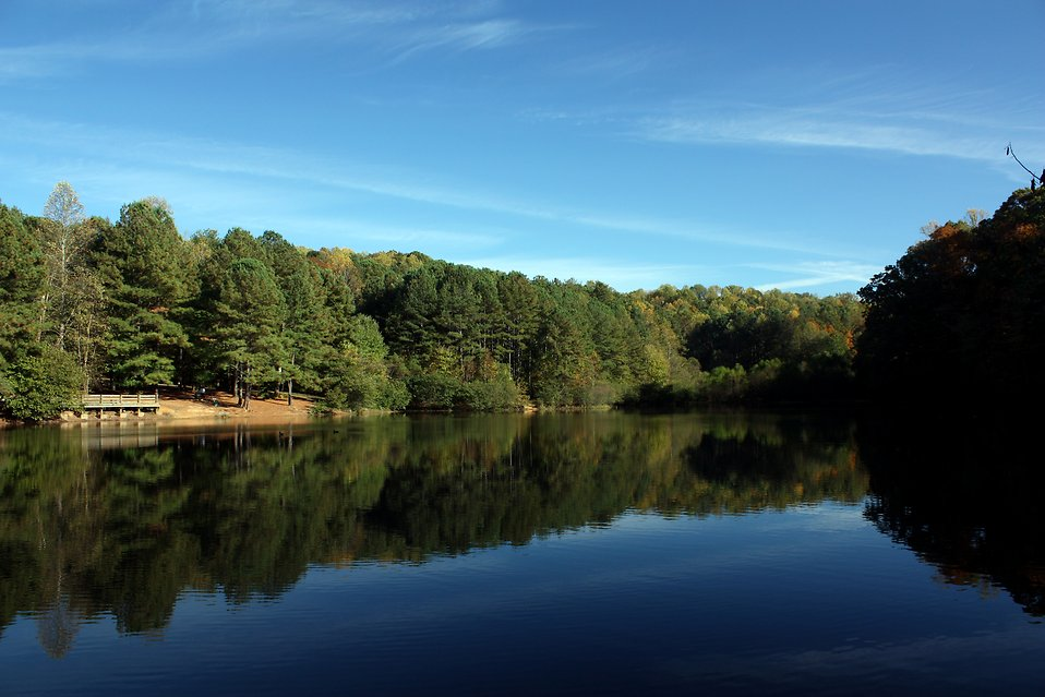 An autumn landscape of trees by a lake : Free Stock Photo