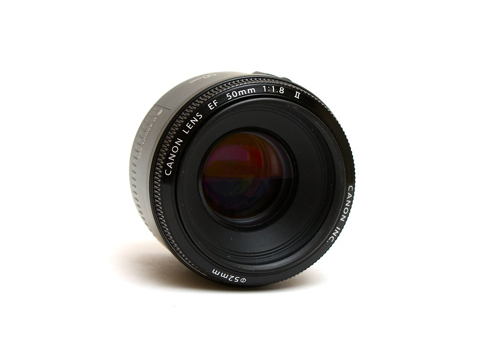 A camera lens isolated on a white background : Free Stock Photo