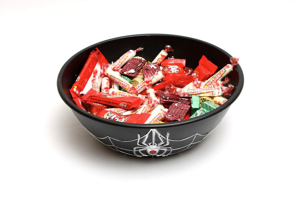 A bowl full of Halloween candy.