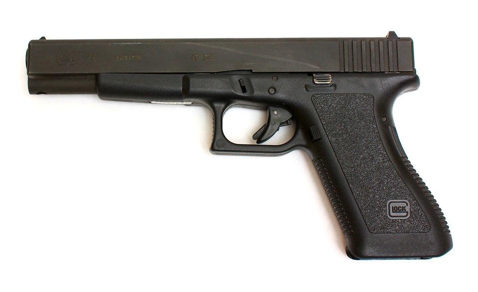 Pistol | Free Stock Photo | A Glock 24 pistol on a white ...