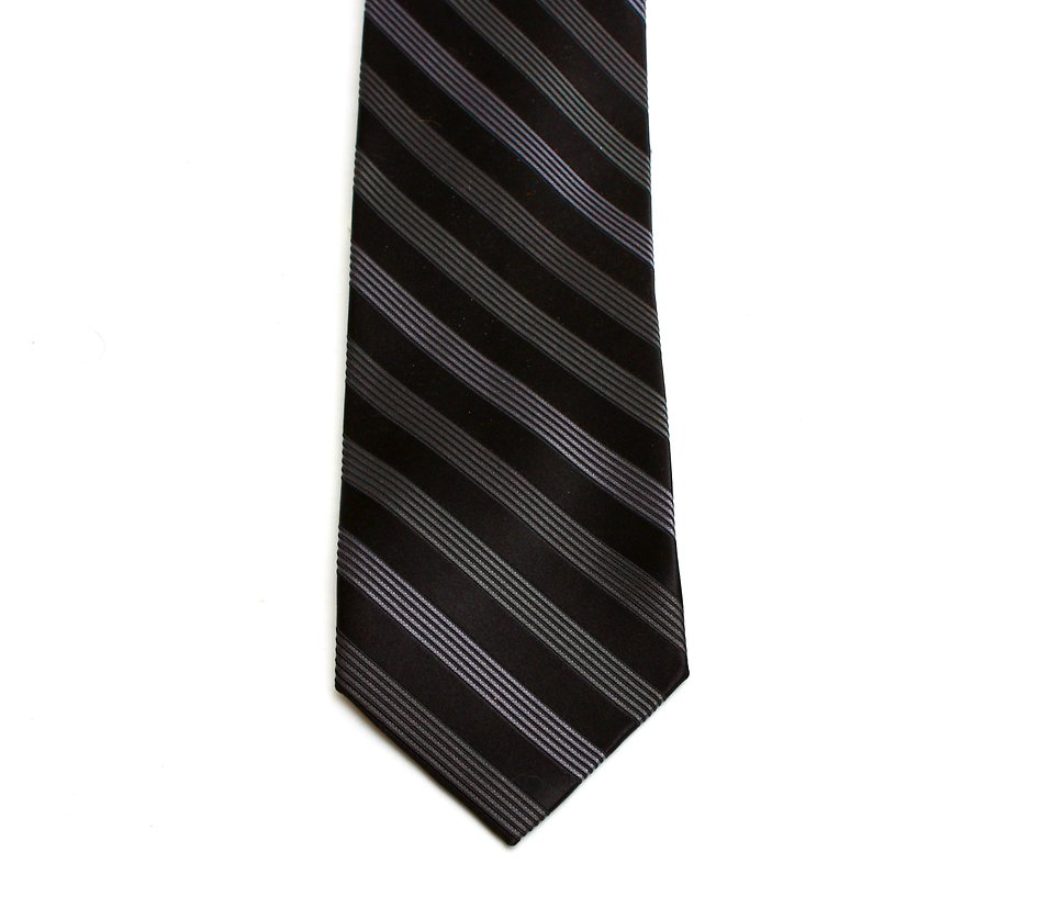 A dark neck tie on a white background : Free Stock Photo