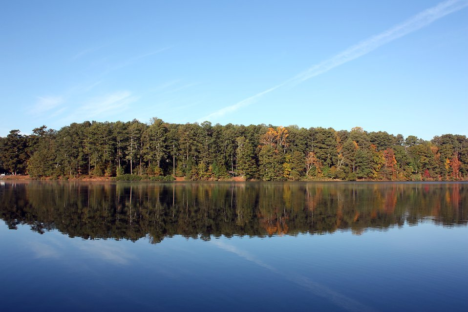An autumn landscape with a reflection in a lake : Free Stock Photo