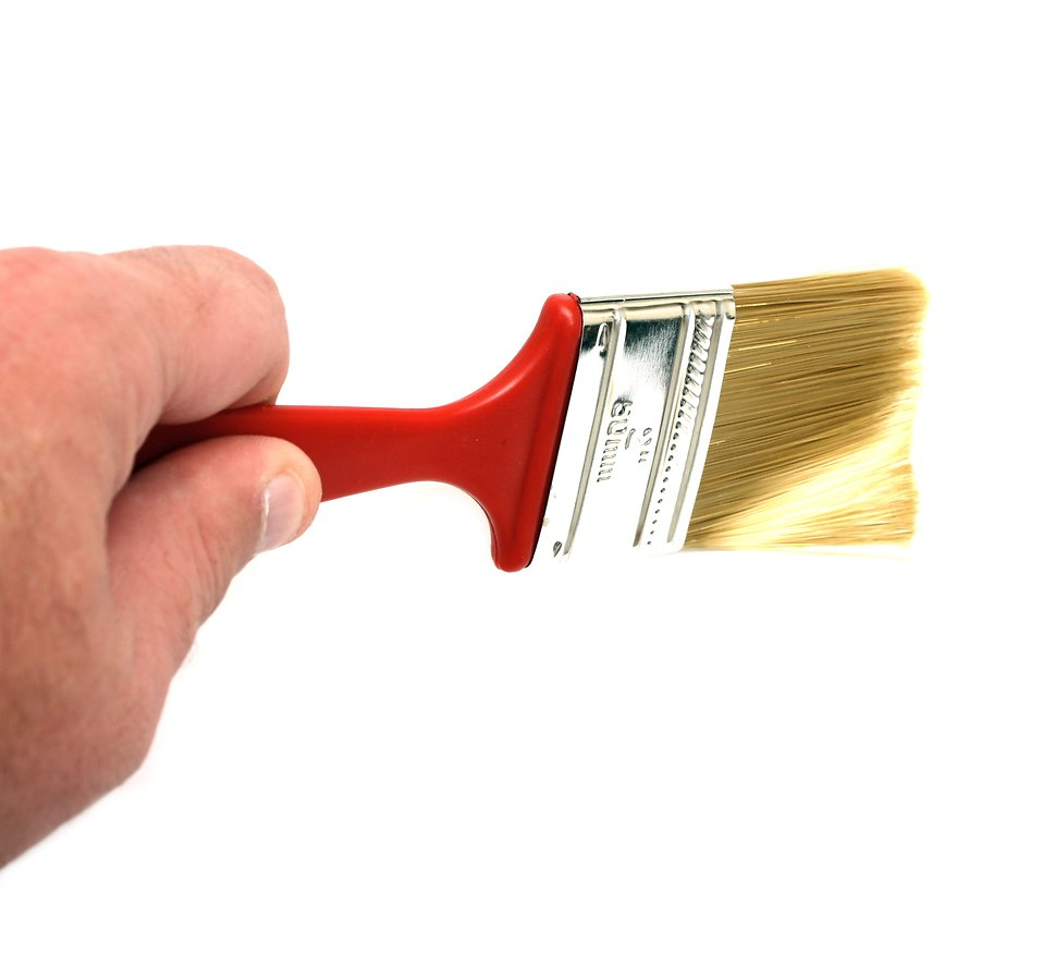A hand holding a paint brush isolated on a white background : Free Stock Photo