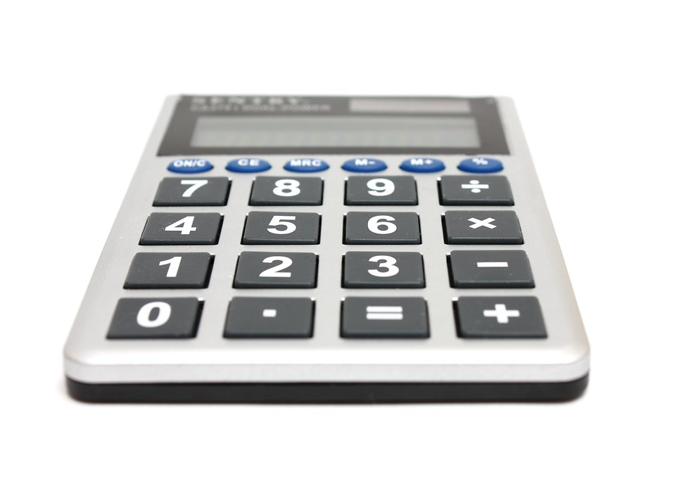A calculator isolated on a white background : Free Stock Photo