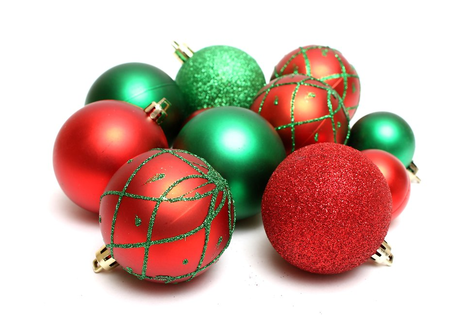 red and green christmas ornaments isolated on a white background free stock photo