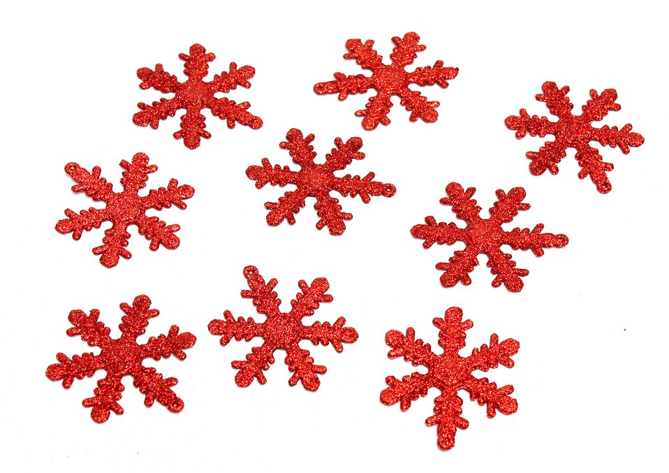 Red snowflake shaped Christmas ornaments isolated on a white background : Free Stock Photo