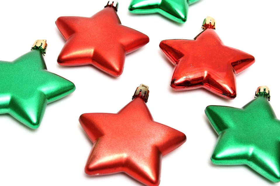Red and green star shaped Christmas ornaments isolated on a white background : Free Stock Photo