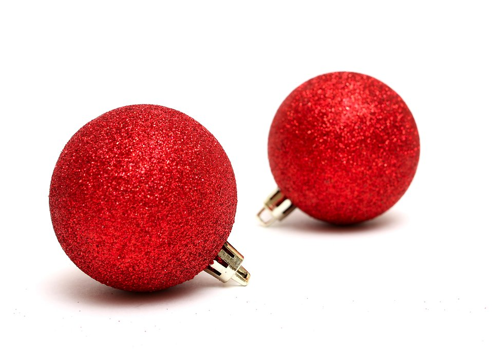 Red Christmas ornaments isolated on a white background : Free Stock Photo