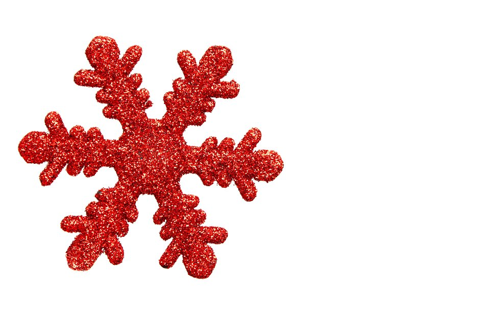 A red snowflake shaped Christmas ornament isolated on a white background.