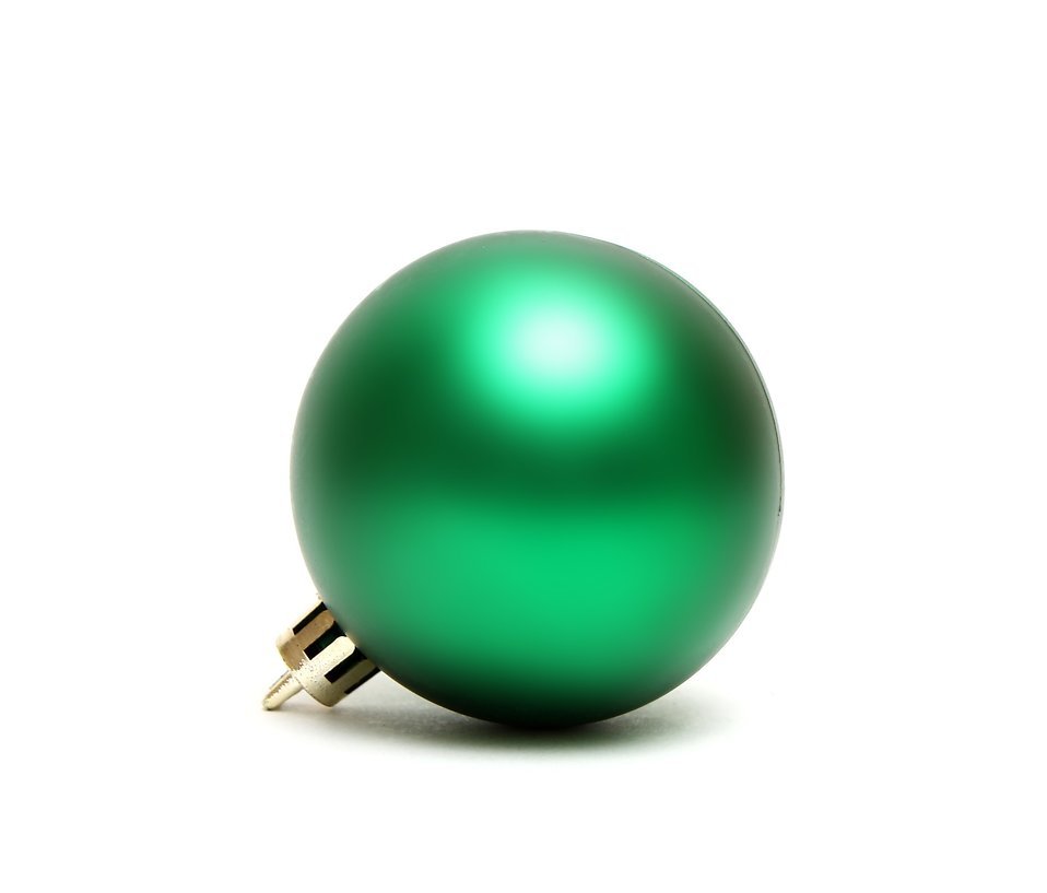 A green Christmas ornament isolated on a white background : Free Stock Photo
