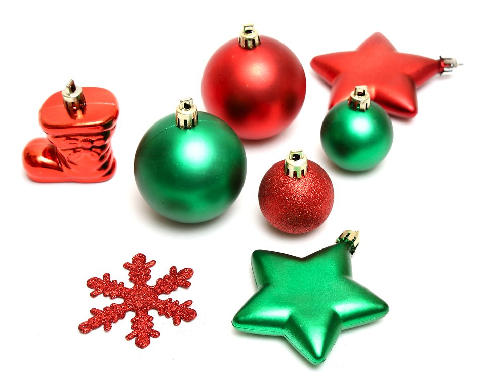 Green and red Christmas ornaments isolated on a white background.