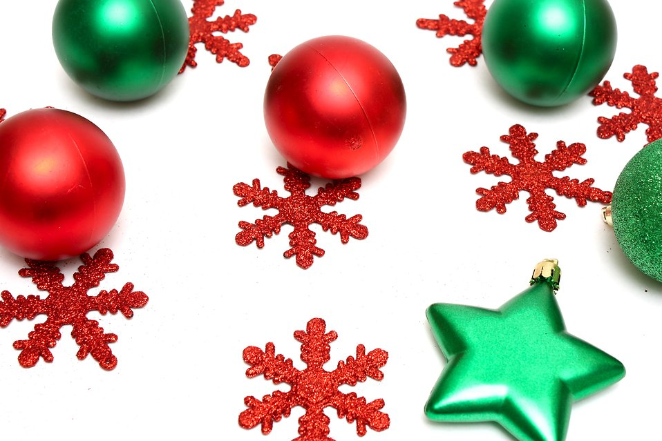 Red and green Christmas ornaments isolated on a white background.