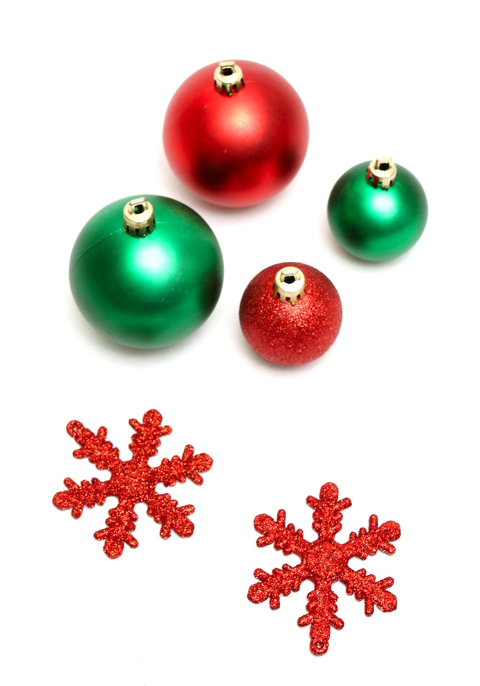 Green and red Christmas ornaments isolated on a white background : Free Stock Photo