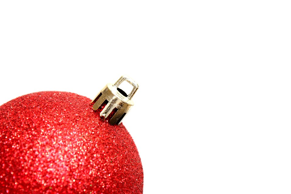 A red Christmas ornament isolated on a white background : Free Stock Photo