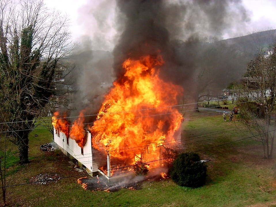 fire stock photo a house on fire  fire a house