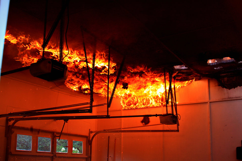 Flames rolling over the ceiling of a garage fire. : Free Stock Photo