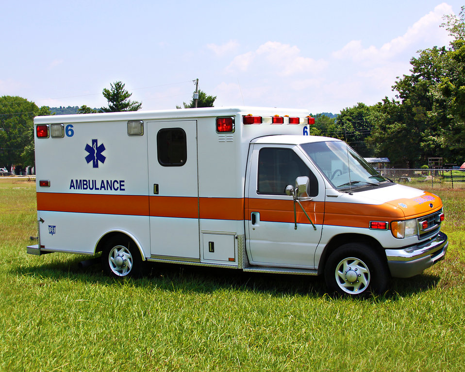 An ambulance parked on the grass : Free Stock Photo