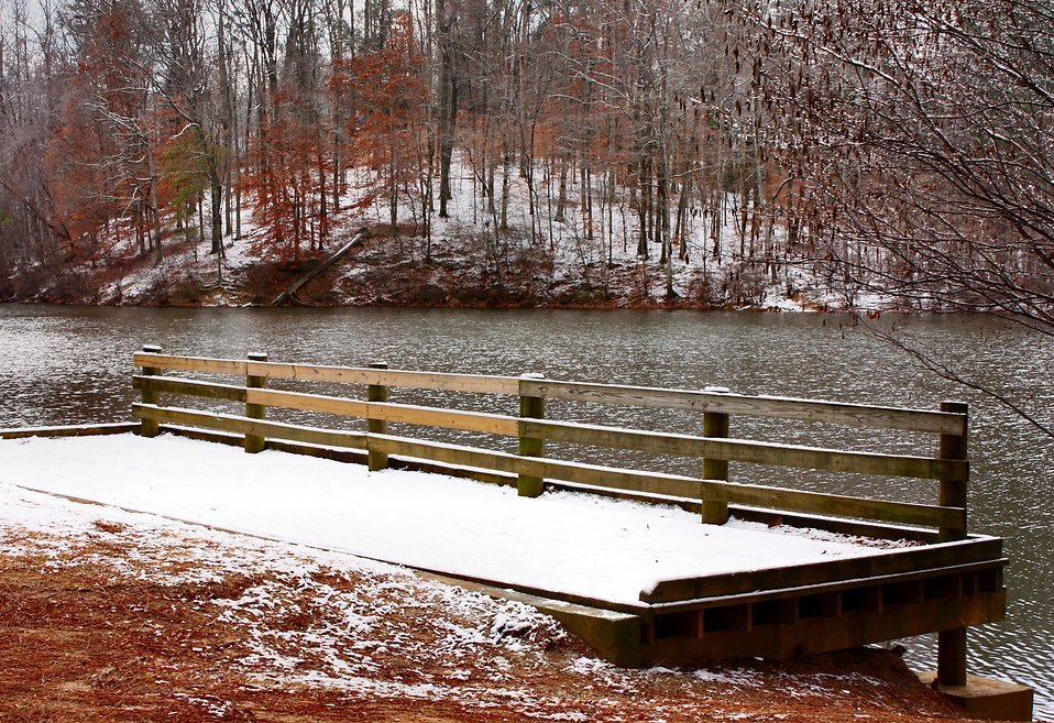A snow covered dock by a lake : Free Stock Photo